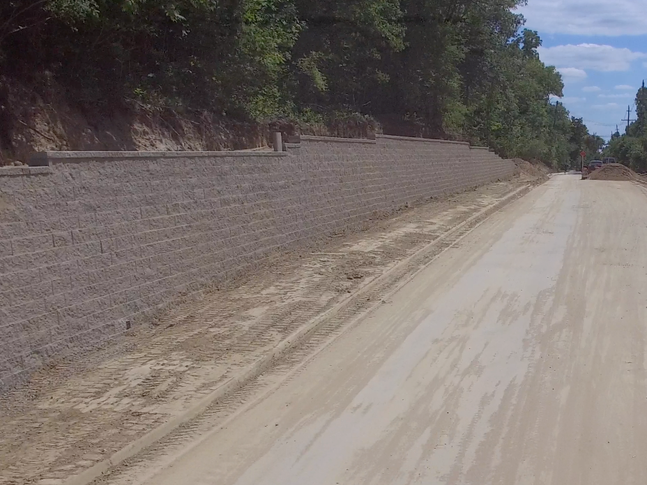Road with brick retaining wall
